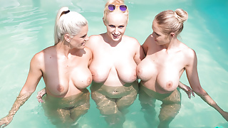 Foursome With Big Tits and a Pool